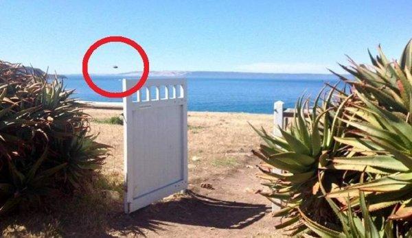 Турист снял на камеру НЛО в форме танка над Австралией